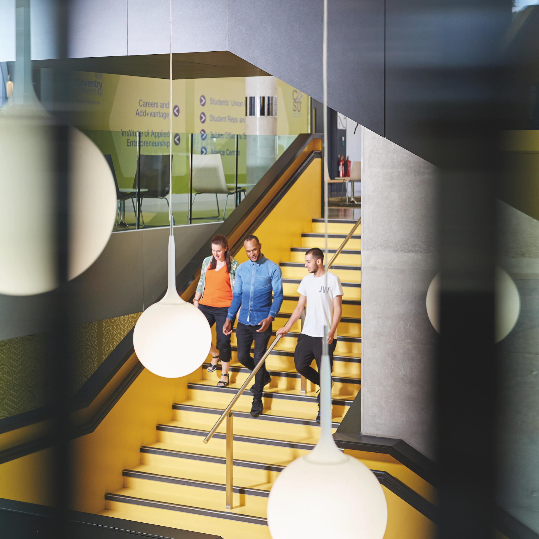 Photograph of students walking down some stairs at Coventry University.